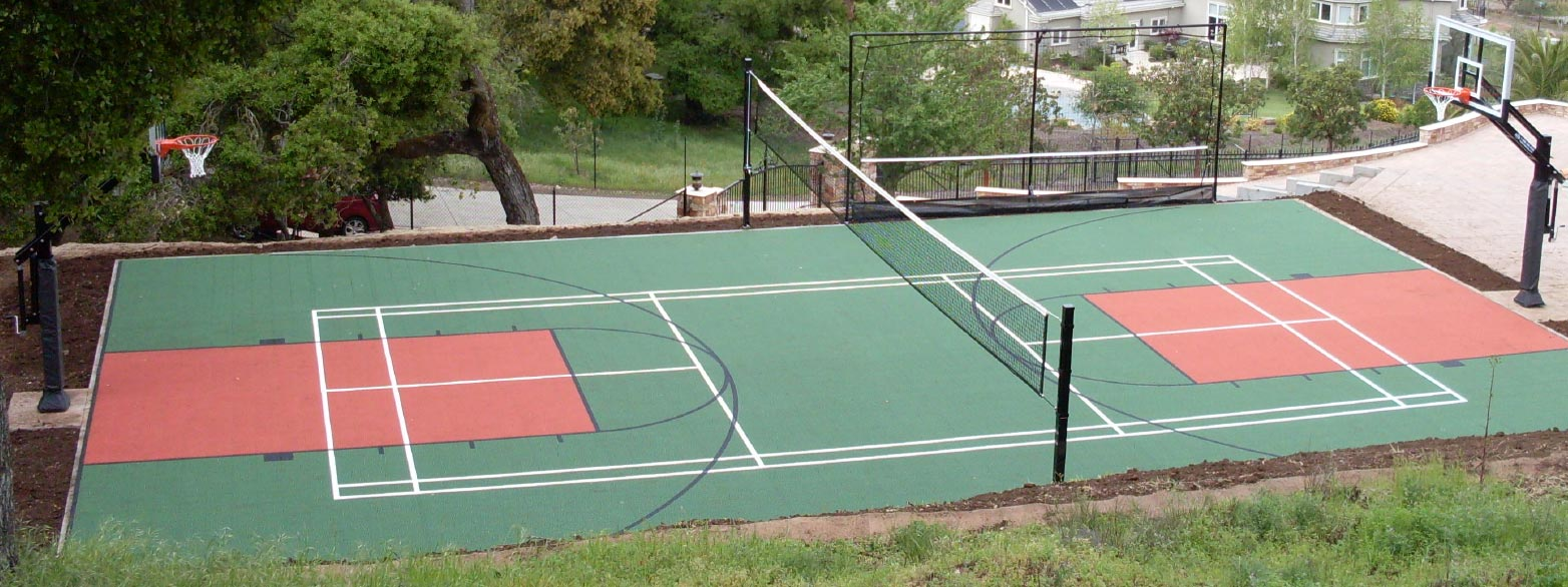 A multi-sport court featuring volleyball and basketball courts